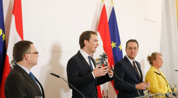 Chancellor Sebastian Kurz speaking at a conference amidst the overhaul of SA.