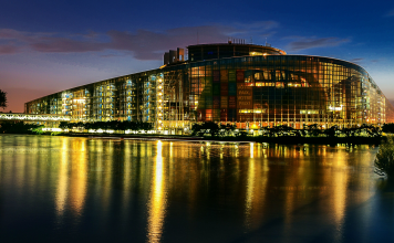building by night next to water