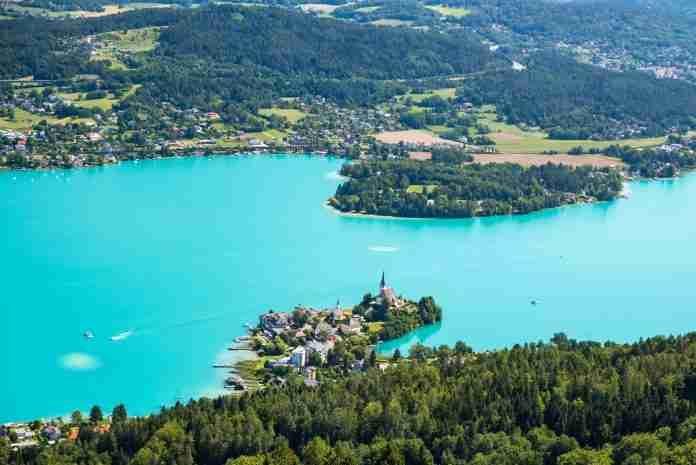 Bird's eye photograph of forest and water in Austria, by Branislav Knappek