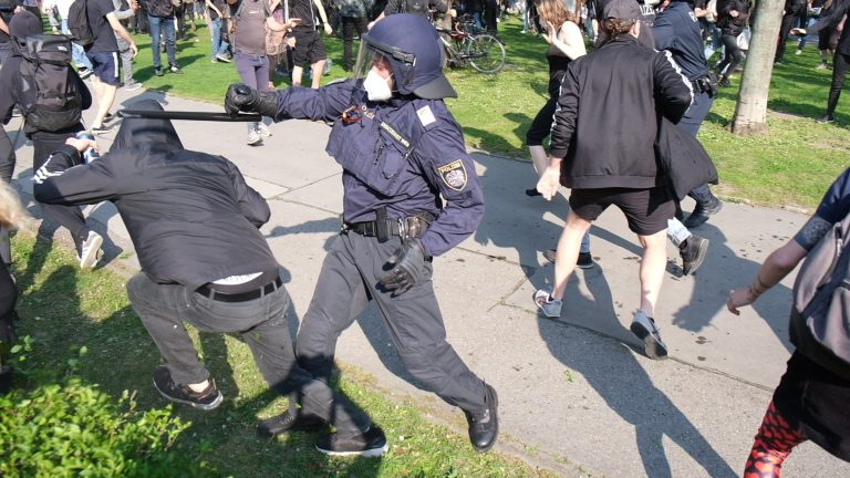 May Day Protest Turns Violent as Protesters and Police Clash at Votivpark